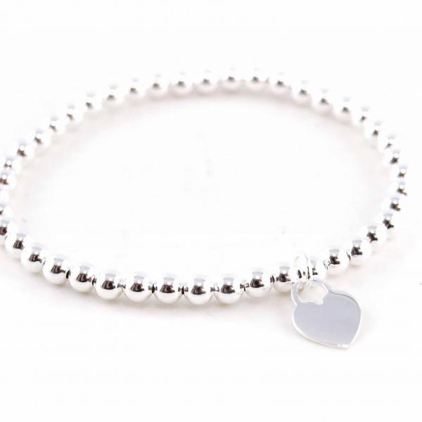 Armband aus Silberkugeln mit Herzanhänger