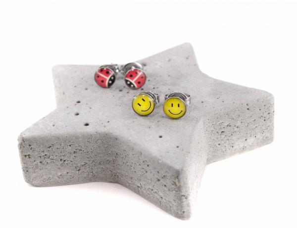 Studex-Ohrringe smiley und Käfer
