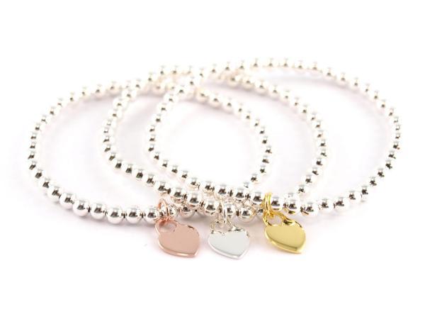 Silberkugelarmband mit Herzanhänger