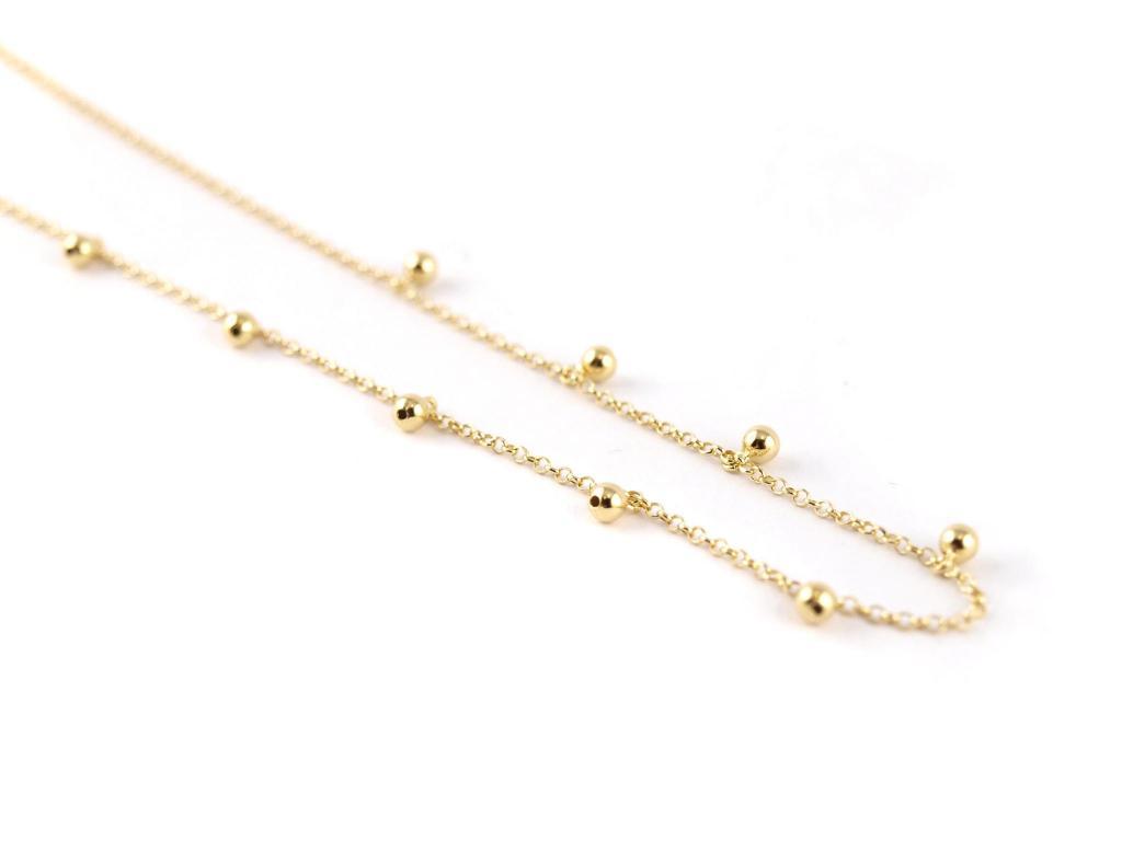 Silberkette mit hängenden Kügelchen, gold