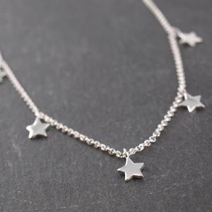 Silber Kette mit haengenden Sternchen